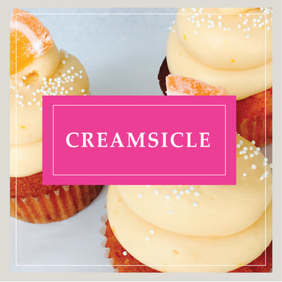 The Creamsicle Tuxedo cupcake at Cupcake DownSouth, a dessert bakery in Charleston, SC and Columbia, SC